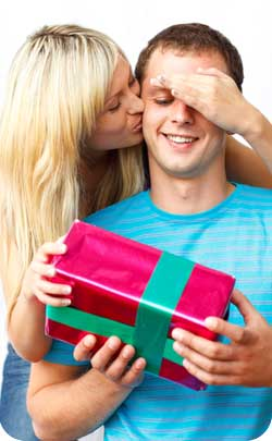 kissing couple giving anniversary gift